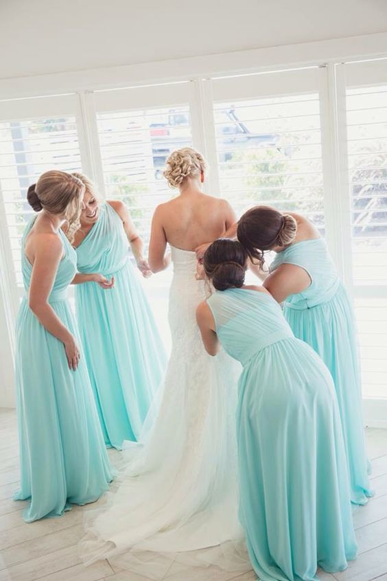 Bridal Party Helping the Beautiful Bride