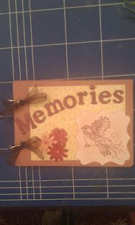 A photo sized memory handmade book with embossed chipboard letters