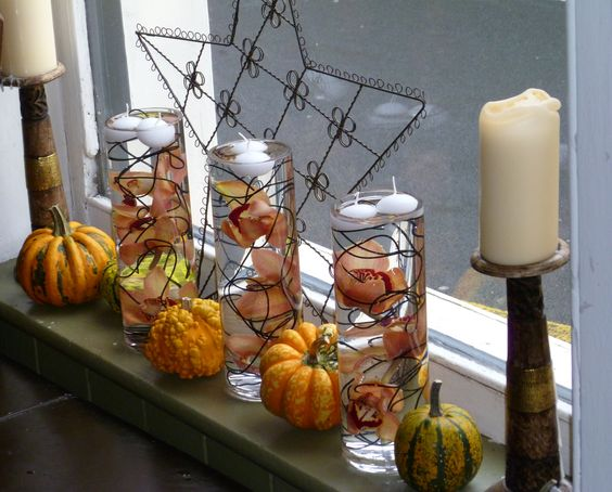 Orchids and floating candles accompany decorative gourds for Halloween