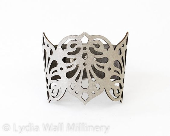 Leather cuff made of metallic Silver leather laser cut in intricate design inspired by Victorian times.    Measures 7, 7 1/2 or 8 inches(18,19
