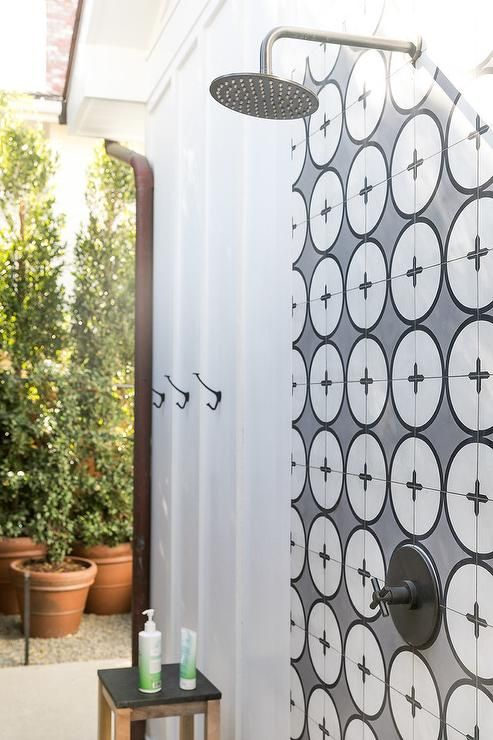 White And Gray Cement Wall Tiles Accent An Open Outdoor Shower