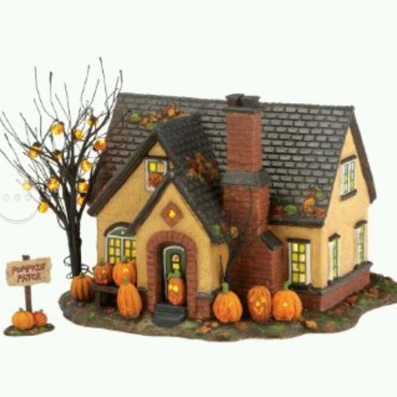 The pumpkin house halloween snow village fall thanksgiving