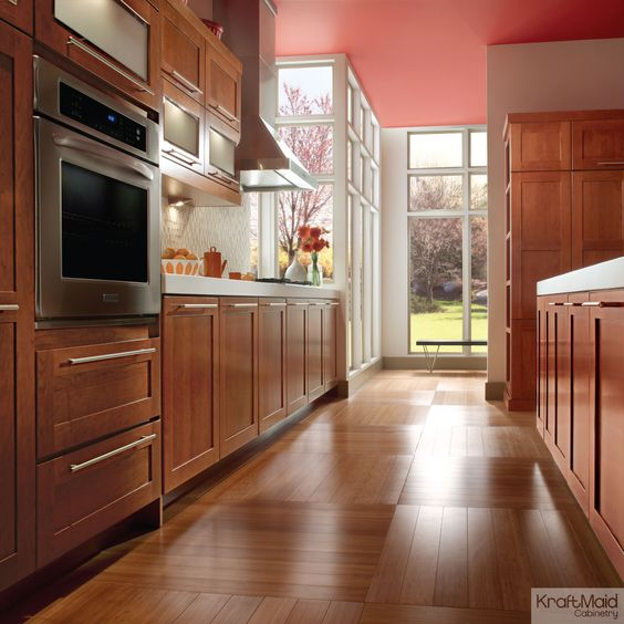 Cherry cabinetry in KraftMaid?s Cinnamon stain adds warmth to this