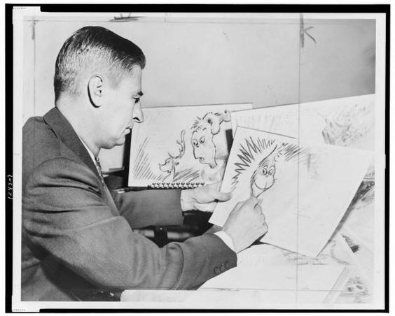 "Dr. Seuss (Ted Geisel) at work on a drawing of a grinch, the hero of his forthcoming book, ""How the Grinch Stole Christmas"" in 1957.:"
