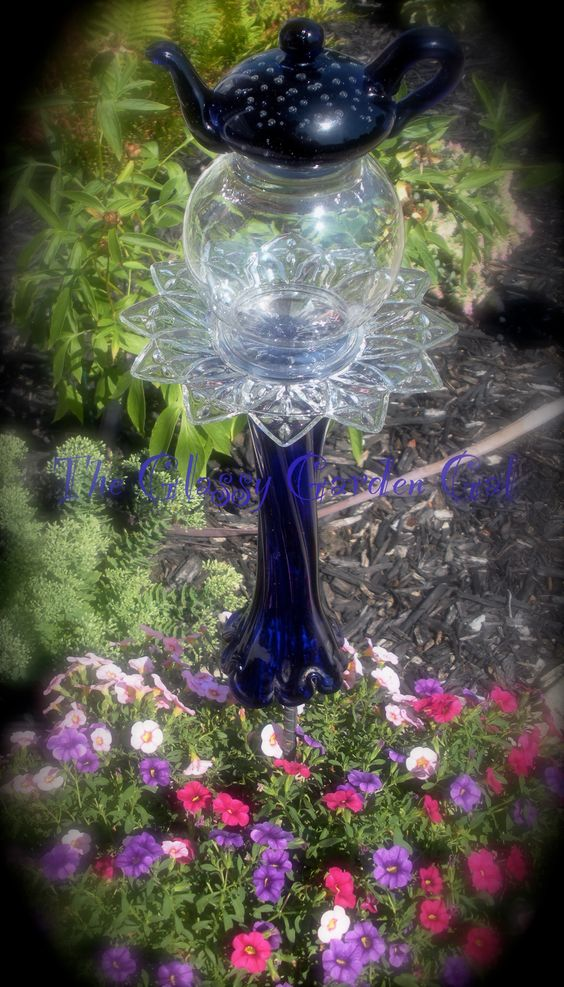 Glass garden glass garden art and garden totems on pinterest for Recycled glass garden ornaments