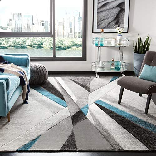 Teal Gray Living Room With Brown Leather Couch We Know How To Do It Mid Century Modern Rugs Midcentury Modern Rugs In Living Room