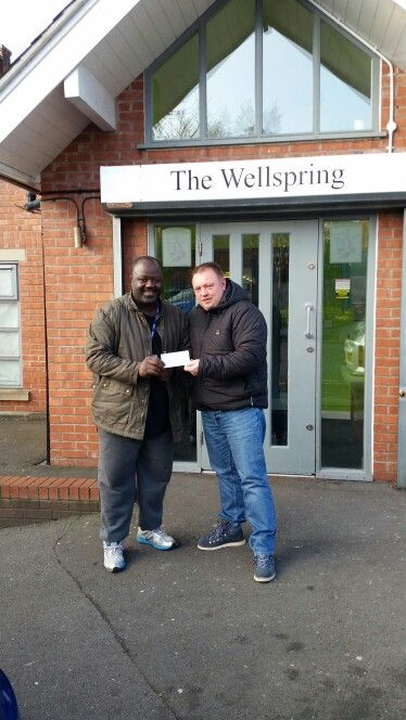 Handing over a cheque from Stockport Carnival Committee