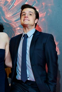 Josh Hutcherson... look at him... just trying to be taller... keep trying babe, just keep trying