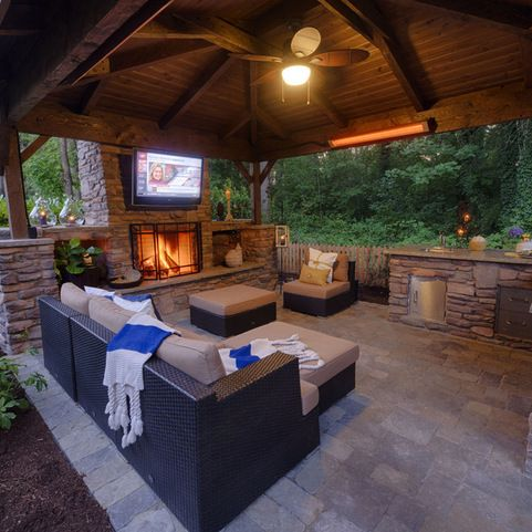 Noelito flow outdoor living covered patios and tvs for Outdoor room with fireplace