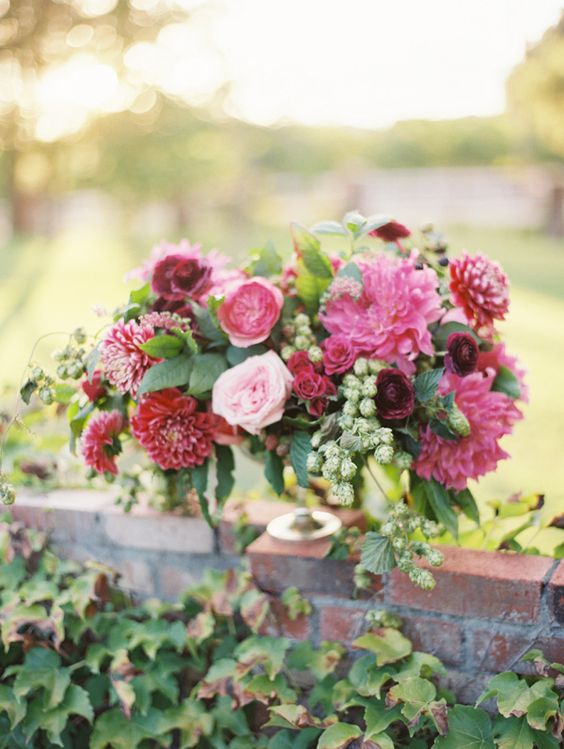 Gorgeous centerpiece consisting of Garden Roses, Ranunculus, Dahlias, Blackberries, and Hops. #wedding #flowers