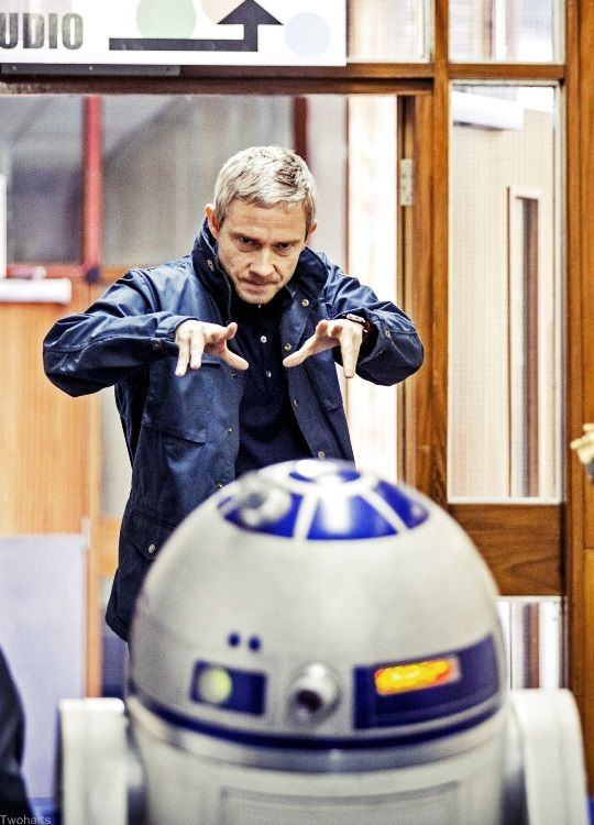 Martin & R2D2. I don't even know what this is, but it's hilarious! Martin looks like he is psychic. :D