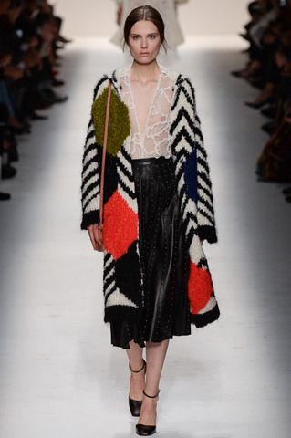 Casual day by Valentino is still eloquent with wide lace V neck blouse, laser cut hole punched midi skirt and a super cool texturized black and white with color splashed print overlong sweater. Want to wear now! Valentino Fall 2014 Ready-to-Wear Collection Slideshow on Style.com