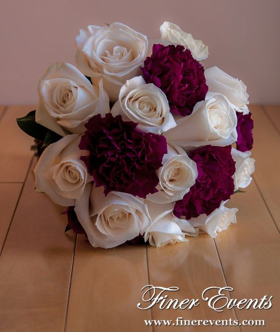 .white roses and magenta carnations made a stunning bouquet.