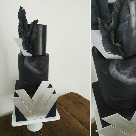 A modern art deco wedding cake. Black marbled fondant with ...