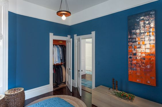 transitional bedroom by Susan Diana Harris Interior Design All the closets in the house were painted orange!