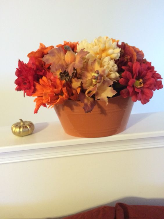 Fall/Autum decor ... Dollar tree  creation, various flowers and orange bucket. Simple and pretty.