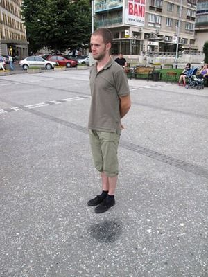 How to take a levitating photo by standing next to a wet spot.