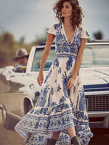 Bluebird Dress   Sweeping, semi sheer maxi dress featuring a V-neckline and cap sleeves with subtle crochet detailing. Button accents with a front slit for an added dose of drama. Smocked waist with drawstring tie makes for an effortless fit. Tiered high-