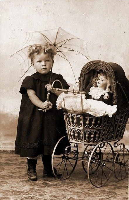 This photo reminds me of Grannies little buggy and all her dolls she collected. Love you Bertha.