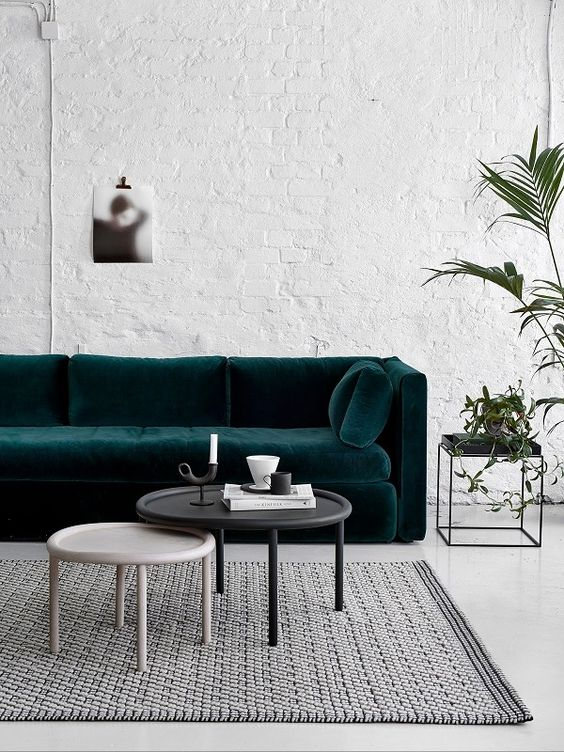 Dark green sofa, white walls: