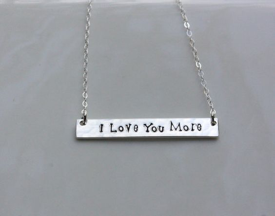 This is a thick gold filled or sterling silver rectangle bar which I custom cut, lightly texture and hand stamp the inspirational message I Love You More. The bar is approximately 1 1/2 long x 5/16 tall and attached to a delicate gold filled or sterling silver cable chain. Your finished necklace will be 18 long. If youd like a different size, please let me know.  Your new necklace will come beautifully packaged and I also include a small disposable polishing cloth to keep your new necklace…