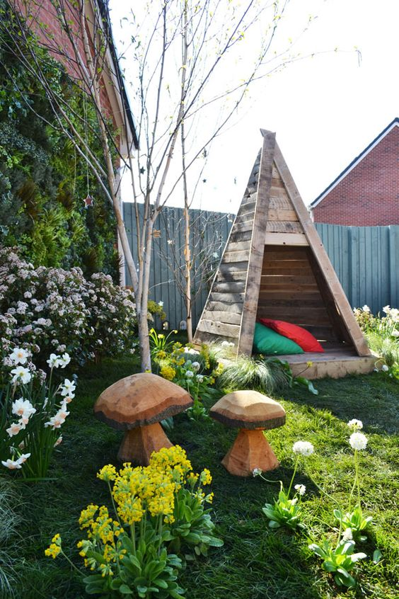 Wooden children's teepee with cut out stars, made from recycled pallets: