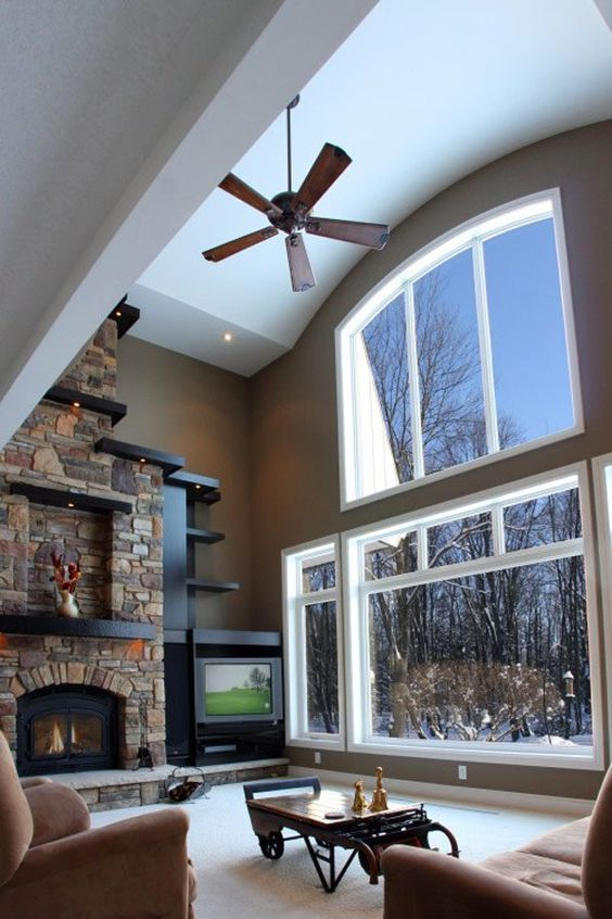 Stone Fireplace Design with lots of recessed lighting