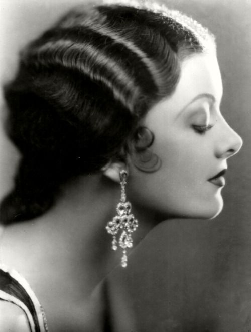 Myrna Loy - she was so unique looking, I always wanted to look just like her:
