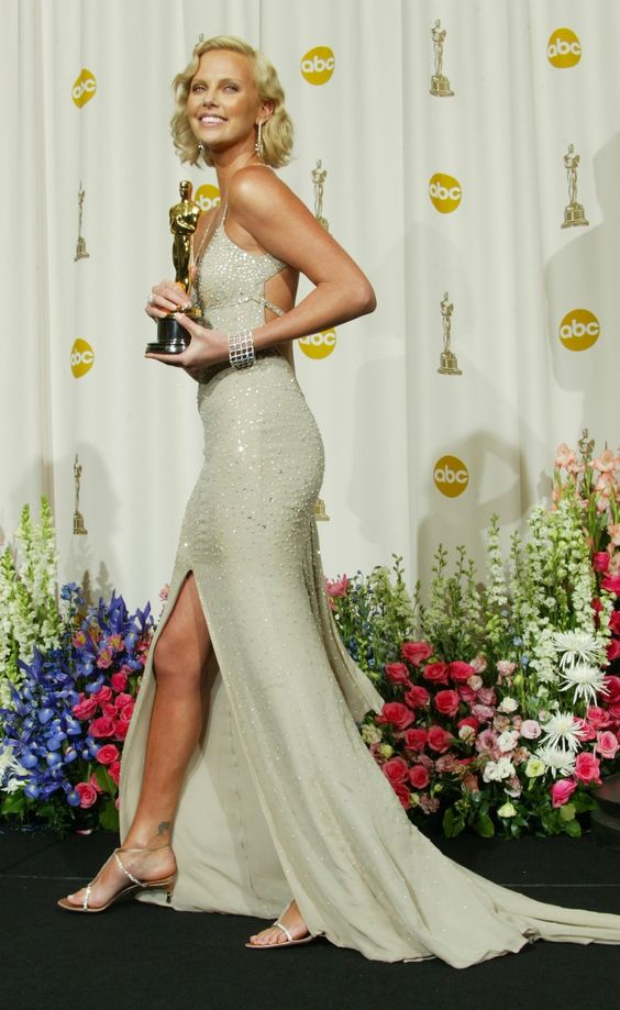 2004: Charlize Theron channels Marilyn Monroe's glamor as she poses with her Oscar for Best Actress.