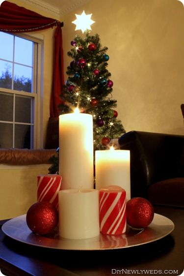 Christmas candles candle centerpieces and centerpieces on for Dining room centerpiece ideas candles