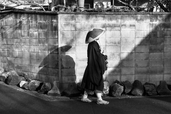 A. Abbas - Kyoto. 2010. MYOSHIN-JI Buddhist temple complex of the Zen Rinzai school. A monk of the TENJU-IN monastery begs for alms in the streets of the city.