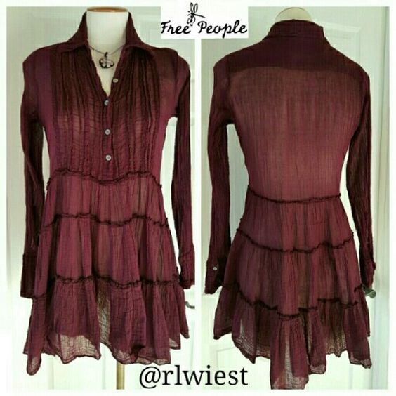 Free People One Tuxedo Tunic Tuxedo-style button front tunic blouse with pleated detailing around front chest. Tiered bottom. Gauzy cotton fabric. 100% cotton. Color is a deep purple/plum. Resale, but in excellent used condition. Free People Tops Tunics