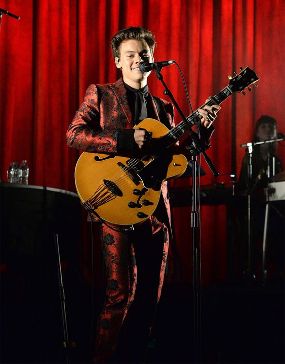 Harry Styles in a custom Gucci metallic floral silk jacquard Monaco suit and silk shirt with self-tie at Radio City Music Hall in New York. Photo: Kevin Mazur/Getty Images