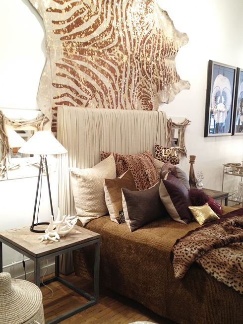 Faux animal skin rug on the wall great idea and can use for Cheetah themed bedroom ideas
