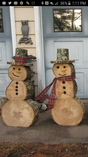 What a great idea! Snowmen made out of recycled logs out of the yard :):