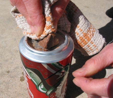 Did you know you can make a fire by using a can of soda and a chocolate bar?