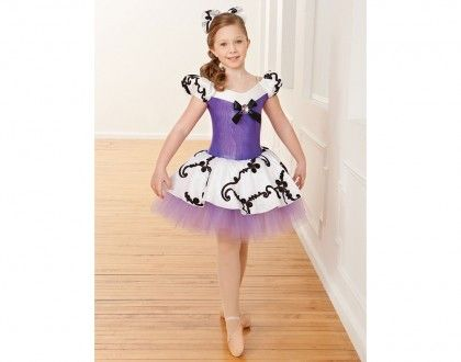 Ref: RV0201  Light purple foil spandex leotard has yoke and trunks of white spandex, off the shoulder sleeves of embroidered taffeta, and a black satin bow with jeweled brooch. Attached European length tutu has a top layer of embroidered taffeta over layers of light purple tulle.