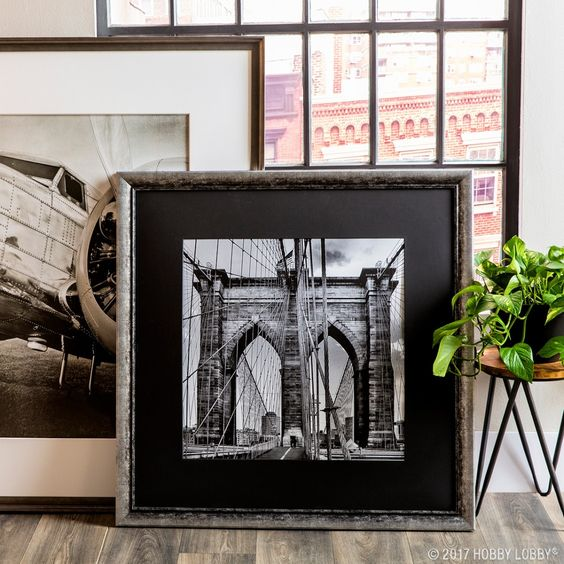 Add elegance to your artwork with architecture-inspired custom frames.