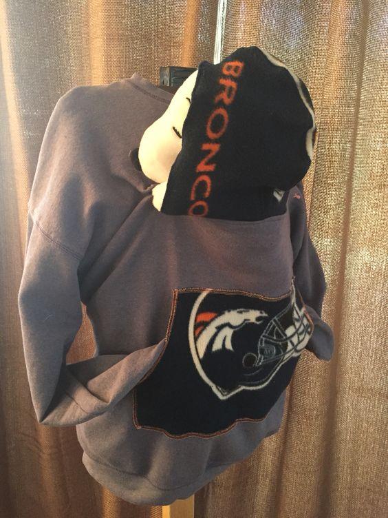 Super Bowl champs Denver Bronco babywearing sweatshirt.