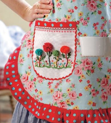 Embroidered flowers with pom-pom flower heads. Too cute!
