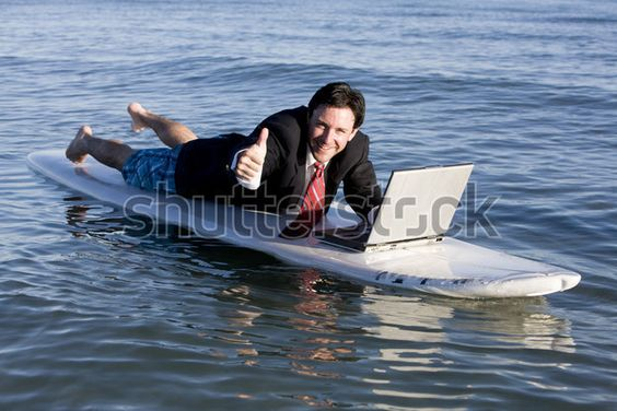 A radical businessman who probably just thinks his water-damaged laptop is a really expensive black mirror: | 50 Completely Unexplainable Stock Photos No One Will Ever Use