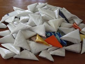 """Mind bomb! Fold grocery bags into these neat little triangles and keep them in your car, purse, etc . So fun you could give out to one of your kids as a """"chore"""" while you put groceries away."""