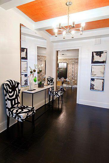 New York City apartment foyer with orange grass cloth ceiling! Whoa.