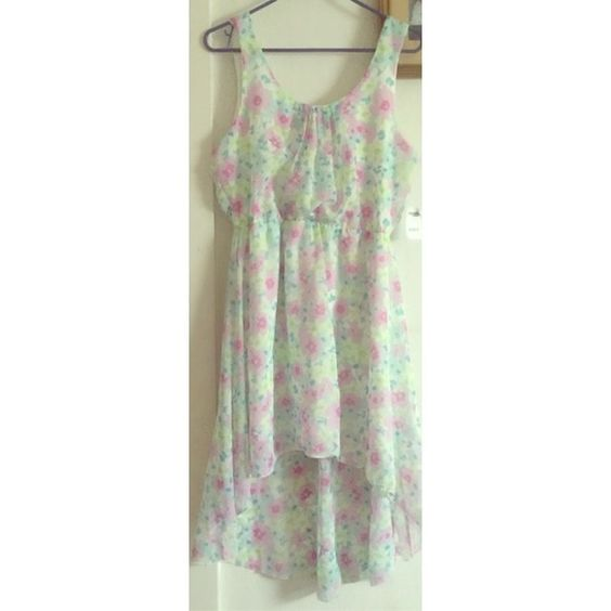 Hi-Low Floral Pattern Dress Hi-Low floral pattern dress brand new, never worn with tags attached. Super flirty and cute great for date night. Charlotte Russe Dresses