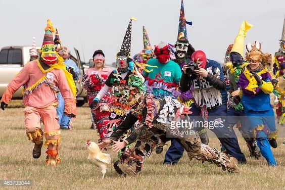 race to catch a chicken during the Faquetigue Courir de Mardi Gras ...