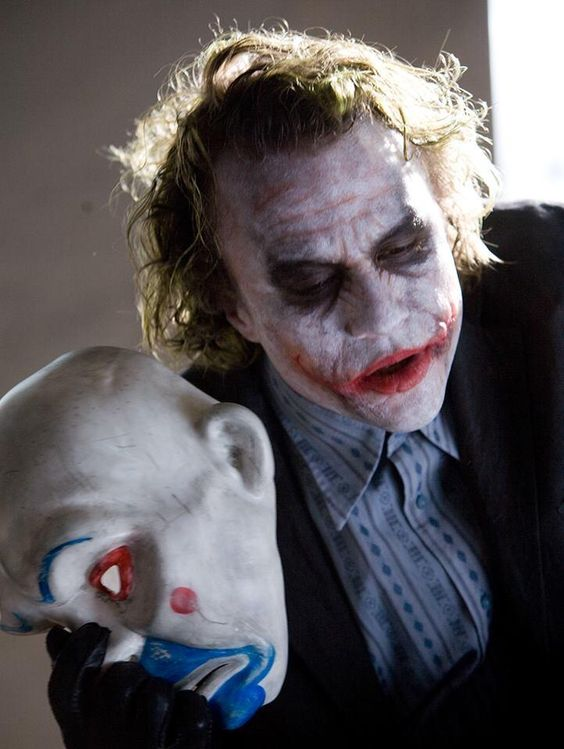 Heath Ledger as The Joker... Wearing a mask dedicated to the original Cesar Romero Joker.: