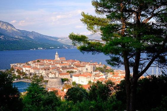 Photo by @kristarossow // Korcula is as pretty as a postcard. While on expedition with National Geographic/Lindblad Expeditions we anchored the Sea Cloud in the harbor and explored the Old Town within the medieval walls. // For more images from my adventure down the #DalmatianCoast to Greece follow me @kristarossow. #Croatia #AdriaticSea @natgeocreative @lindbladexp