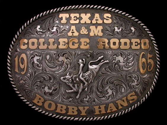 Handmade rodeo buckle. Gold lettering and solid sterling base, rope border and bull riding figure. Buckle was made new but crafted to look old by request. Hand made by Sierra Silversmiths.