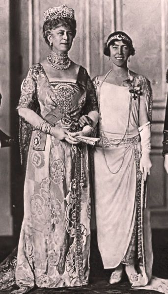 A very nice photo of Queen Mary of Great Britain and Queen Elisabeth of Belgium,1920s, both of them looking more cheerful than their wont (at least in photos!).  Queen Mary still in the garb of Edwardian days, and Queen Elisabeth with her shorter (looking) hair, bandeau, shorter skirt and dropped waist.  It's said that Queen Mary would have adopted more modern styles if King George had permitted it.
