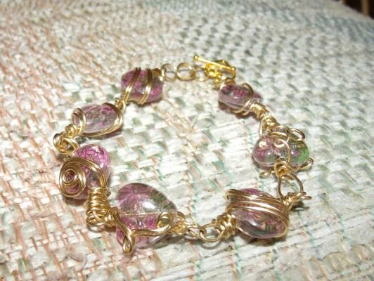 gold tone hand wrapped bracelet